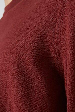 tröja stickad laado vinröd modell närbild