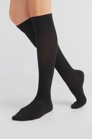 knästrumpor bomull svart modell korsade ben