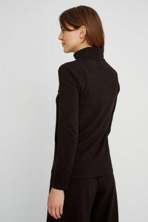 tröja polo laila svart modell bakifrån